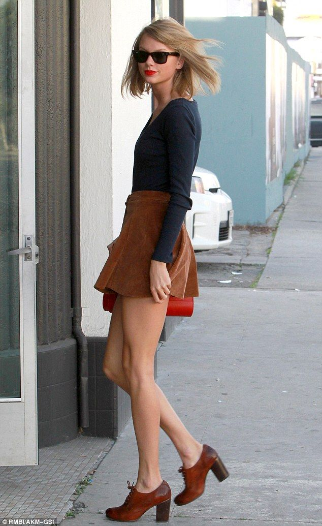 Not worried: Taylor Swift was in LA on Tuesday and stopped off at some photography studios in West Hollywood, California