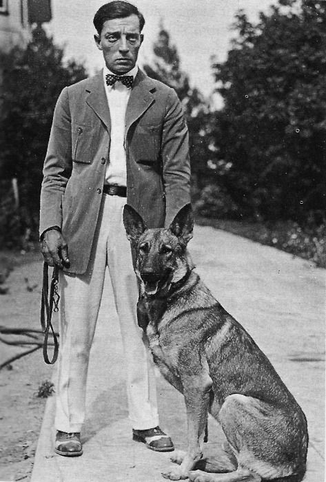 """Buster with his German Shepherd - """"Captain."""" The police dog was a wedding gift to Buster & Natalie, but he soon turned out to be a real """"Daddy's Dog."""" According to Buster, the dog slept in bed with him - and took up the whole thing, leaving Buster squished into a corner."""