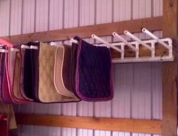 This PVC Saddle Pad Wall Rack would be a great idea for in the garage for other items.