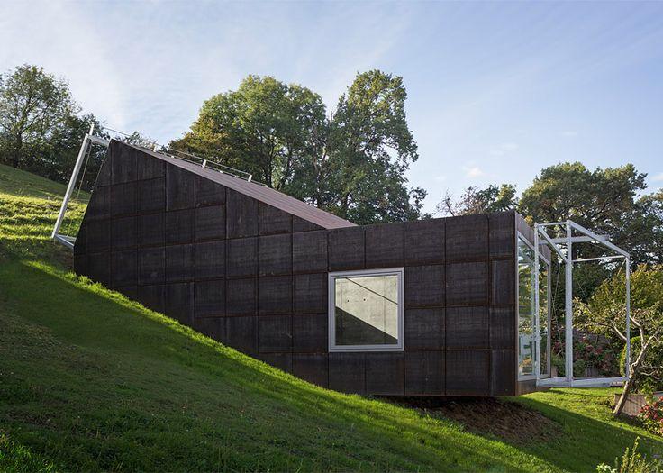 Tick Shaped Art Studio That Follows The Slope Of An Austrian Hillside.