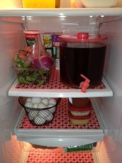 Make your own fridge mats from plastic place mats. Easy, cheap and great for fast cleaning.