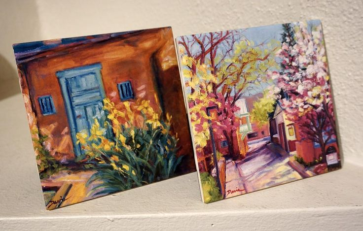 We just printed and fired these tiles with the artwork of local painter Terry Davis. We also have her original oil paintings and giclee prints.