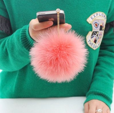 Kawaii dust plug ear cap - Ostrich fur. $20.90, via Etsy.