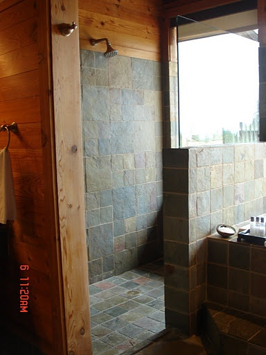 Shower without doors stonework is nice too much wood for for V bathroom opening hours