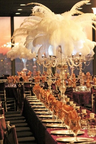 Ostrich feather centerpieces atop crystal candelabra and
