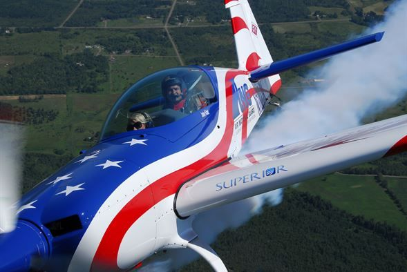 U.S. Air Force Major John Klatt, 148th Fighter Wing Pilot, flies a local reporter in the ANG aerobatic demonstration plane over Duluth, Minn. on 14 July, 2008.  John Klatt and the Guarding America, Defending Freedom Aerobatic team will be performing at the Duluth Air Show to promote the Air National Guard 19-20 July, 2008 . (U.S. Air Force photo by Tech. Sgt. Jason W. Rolfe)  (Released)