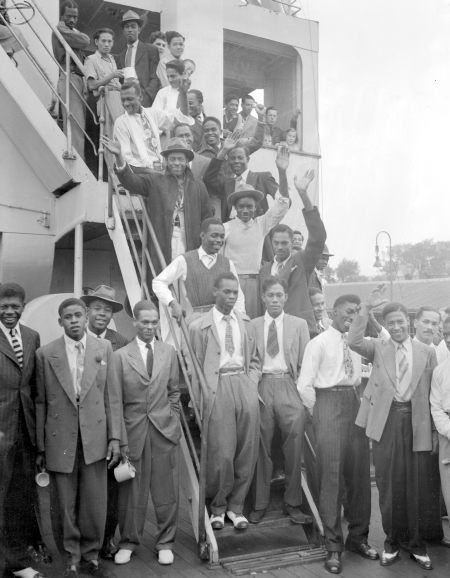 Jamaicans disembarking the Empire Windrush in 1948.