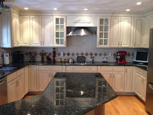 Glazed kitchen cabinet makeover here a dark kitchen is painted with a general finishes - Antique white cabinets with black glaze ...