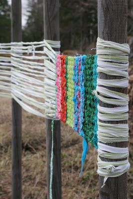 Use trees, fenceposts, porch rails, table and chair legs, etc. to do a weaving, cut the ends, tie off. Ideal for live art! Include paper strips, plastic bags, old clothes, whatever is on hand, adding embellishments as you go.