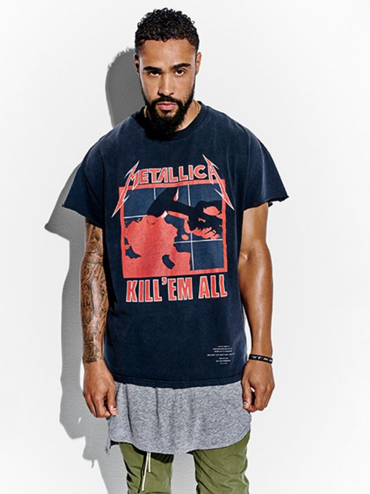Jerry Lorenzo wearing a vintage Metallica rock tee layered with fear of God tank And trousers