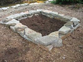 How to Build a Stone Raised Bed. Great idea using stone rather