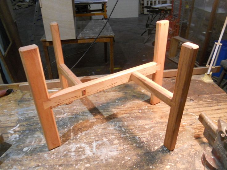A small side table of Zimbabwean teak on the workbench.