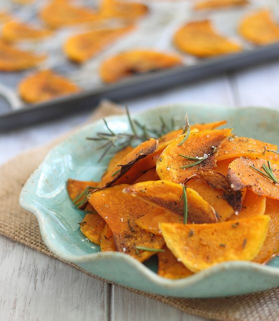 CRISPY BAKED BUTTERNUT SQUASH CHIPS  Ingredients  1 small and skinny butternut squash  2 sprigs fresh rosemary, chopped  kosher salt  pepper  extra virgin olive oil