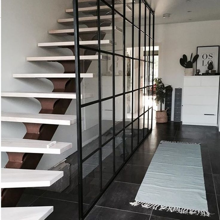 Metal wall seperating stairs from the corridor by Dominius AS