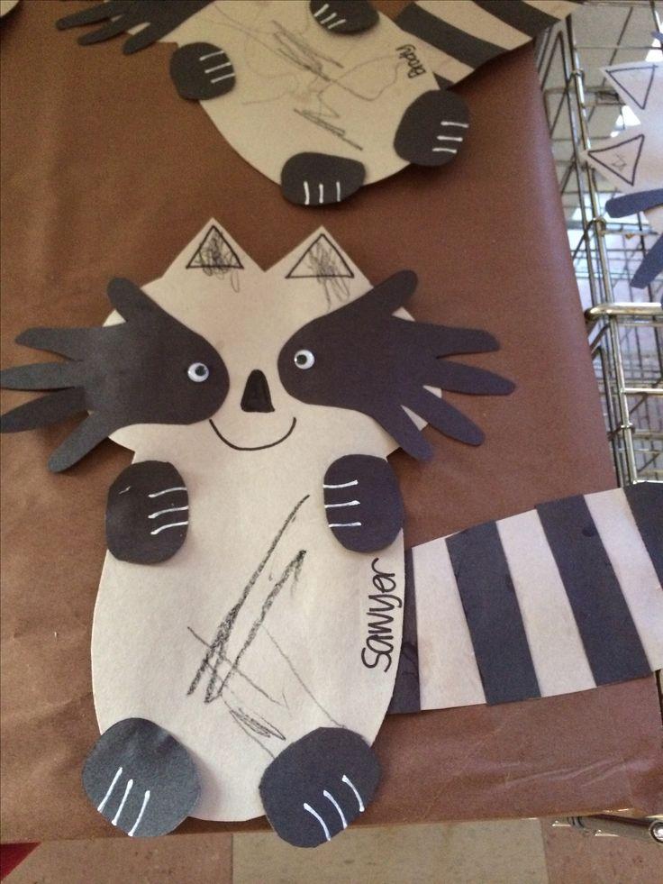 "Raccoon with handprint ""eyes"""