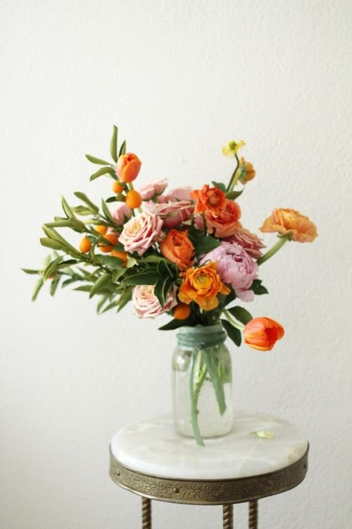 Love the orange and green accents in this floral arrangement.