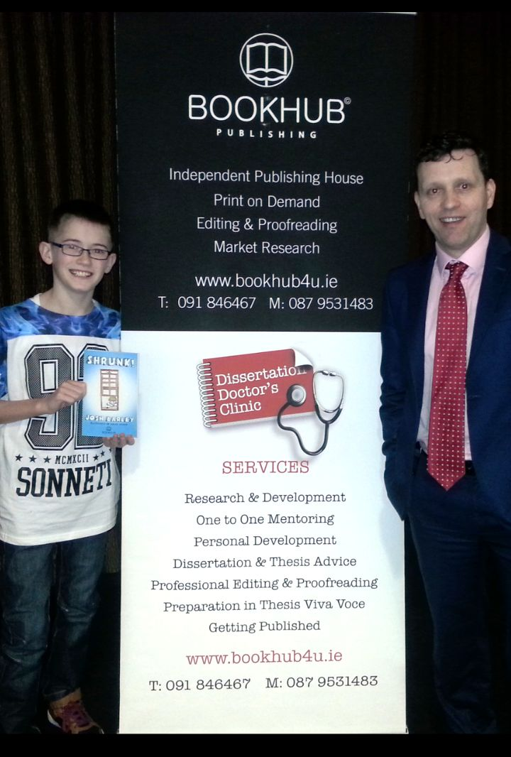Young author extraordinaire, Josh Earley with Dr. Niall McElwee, MD of Book Hub Publishing.