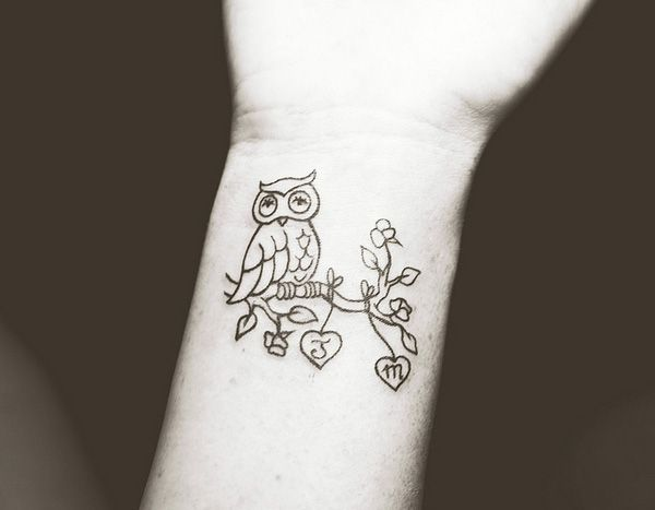 36 owl tattoo on wrist
