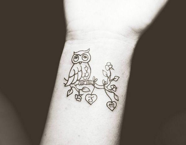 36 owl tattoo on wrist