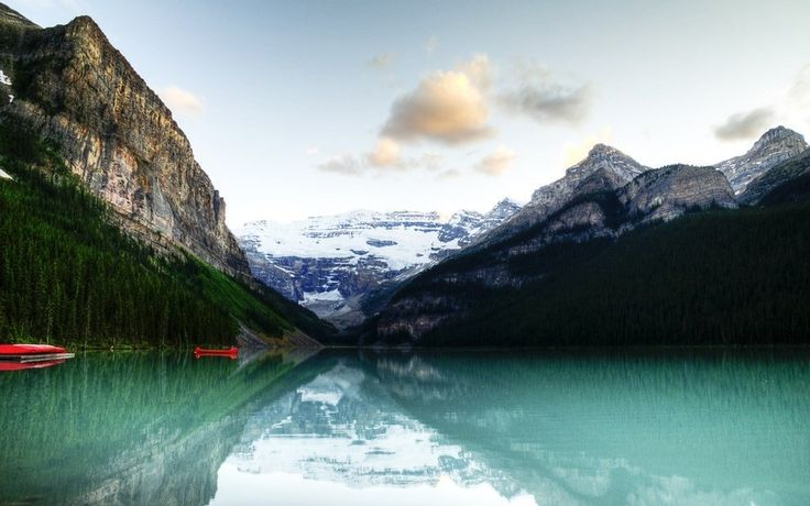 Lake Louise glistening in the early morning.   14 Sites In Alberta That Will Make You Feel Alive