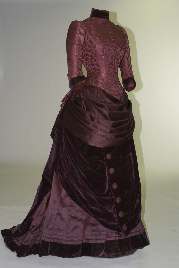 Two-piece dress, G & E Spitzer, Vienna, 1879. Purple silk damask with boned bodice, bustle, and train.
