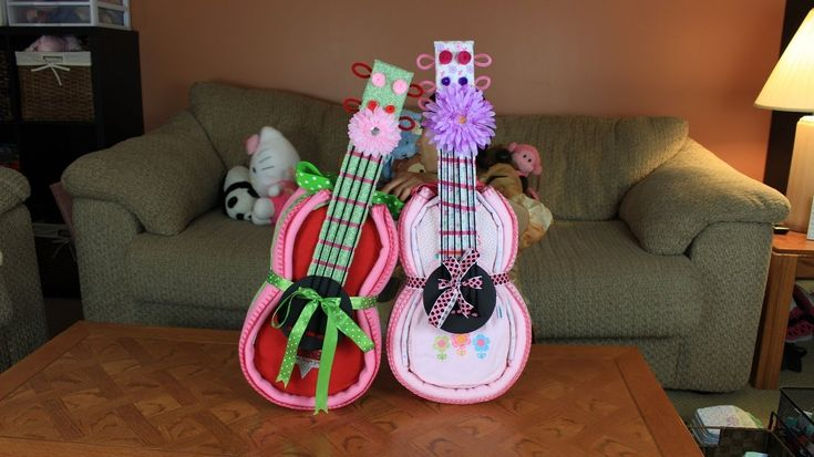Guitar Diaper Cake. buy big stuffed animal to hold it