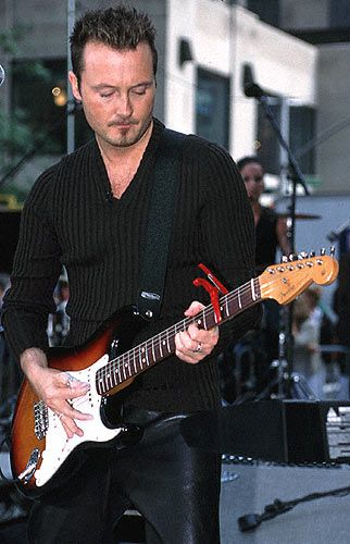 "James Steven Ignatius ""Jim"" Corr (born 31 July 1964) is an Irish musician, singer and songwriter."