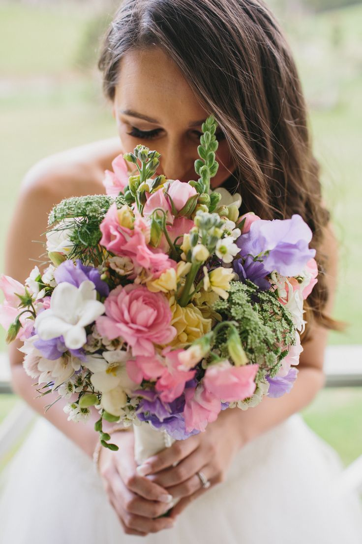 Wildflower bouquet or ranunculus, sweet peas, freesias, stock and queen anne's lace.