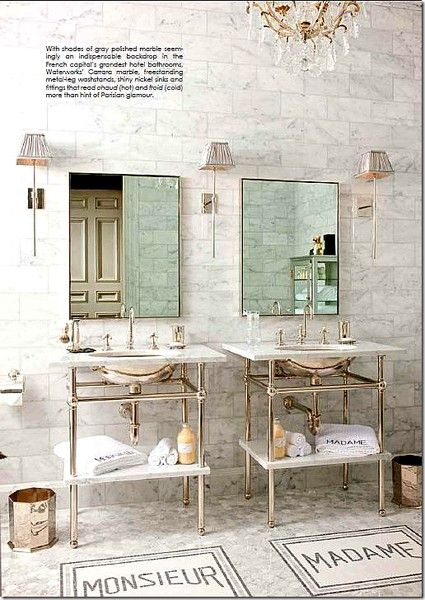 Metal consoles and thin mirror as wide as sink.