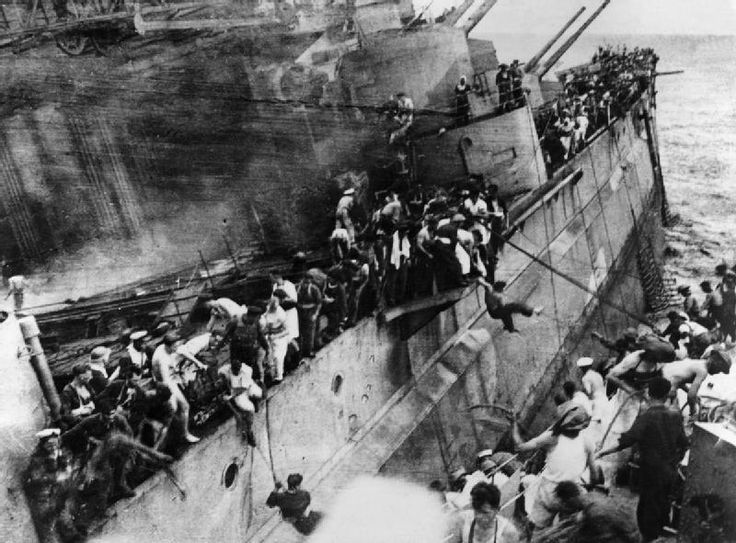 Sailors escape from a sinking HMS Prince of Wales, minutes after it was struck by Japanese bombers. Malaya, c.1941.