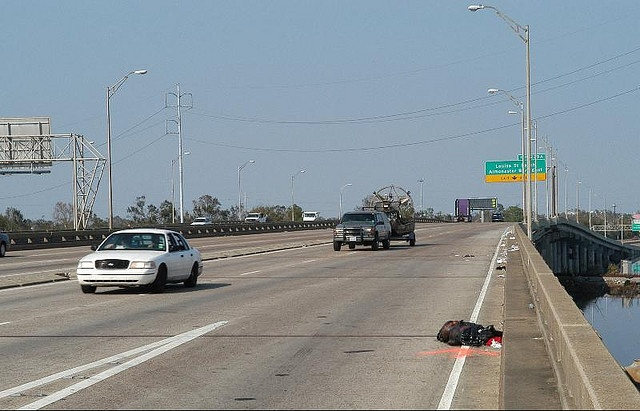 A dead body is left on the I-10 highway 13 days after hurricane Katrina, in New Orleans, Louisiana, on September 9, 2005.