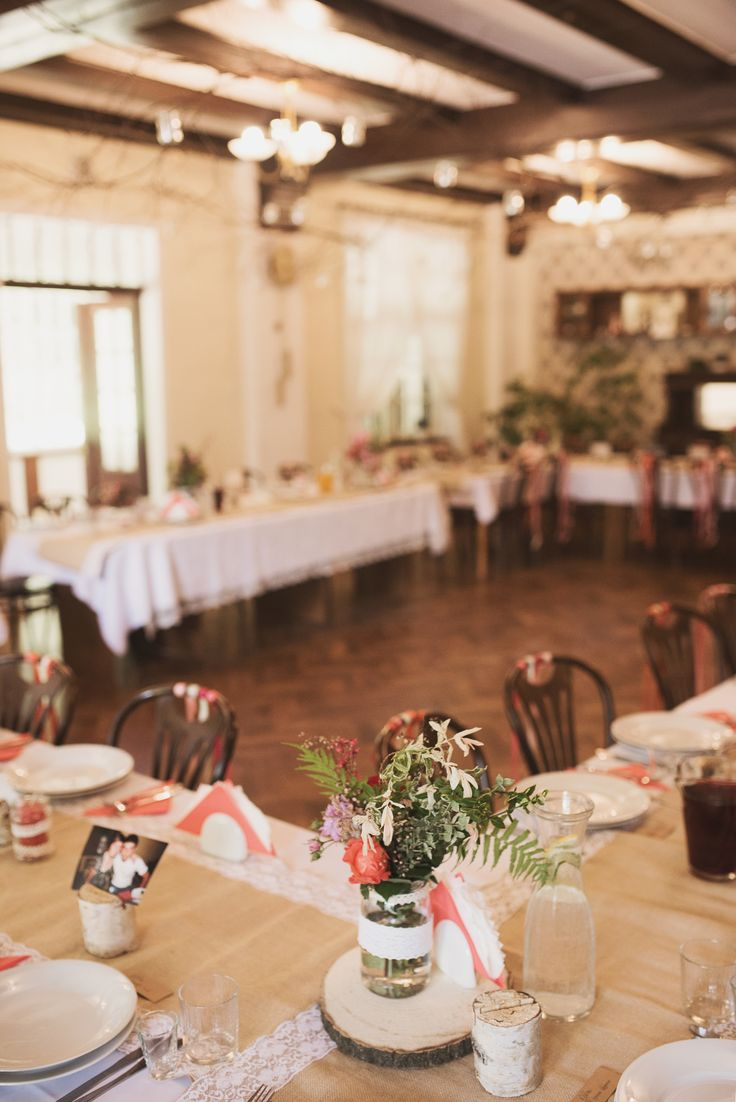 Flowers and candles in decorative jars, colorful ribbons and wooden stands for guests pictures by GRUNT STUDIO