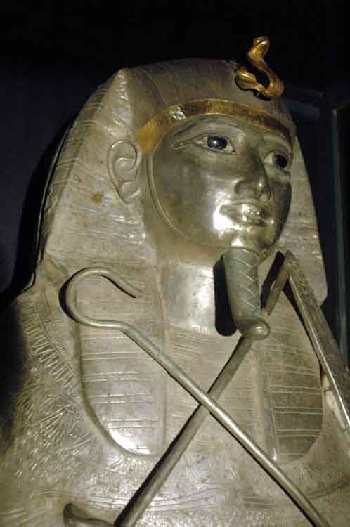 """Silver anthropoid coffin of Psusennes I, who was the third king of the 21st dynasty of Egypt who ruled from Tanis between 1047 – 1001 BC.  Professor Pierre Montet discovered pharaoh Psusennes I's intact tomb in Tanis in 1940.  Unfortunately, due to its moist Lower Egypt location, most of the """"perishable"""" wood objects were destroyed by water."""
