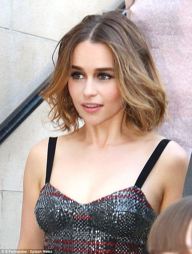 Natural beauty: Emilia had pulled out all the stops for her appearance, choosing a low-cut dress from the latest Bottega Veneta collection, which was red and grey