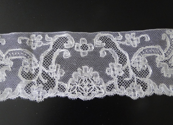 Mechlin lace. Not sure if mid 18th or mid 19 c. probably mid 19th c