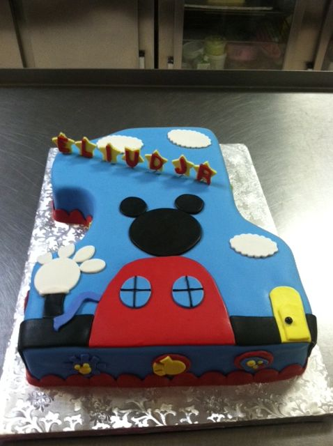 Mickey Mouse Clubhouse cake in the shape of number one.