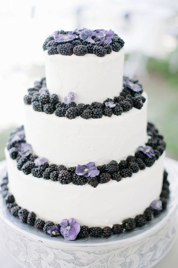Blackberries and mauve pansies on wedding cake.  Great for late summer wedding.