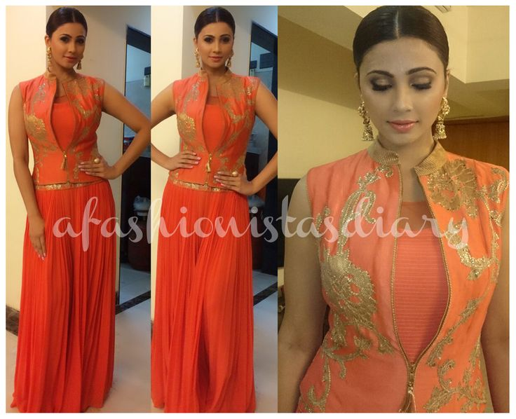 DAISY SHAH Her orange Indian attire consisted of a chiffon like jumpsuit with palazzo pants and a beautiful gold embroidered jacket, all by Diva'ni.