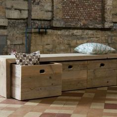 Wooden storage bench. Allow you to store books, shoes and other items in the bench, and sit on it while having the supply's in the compartments.