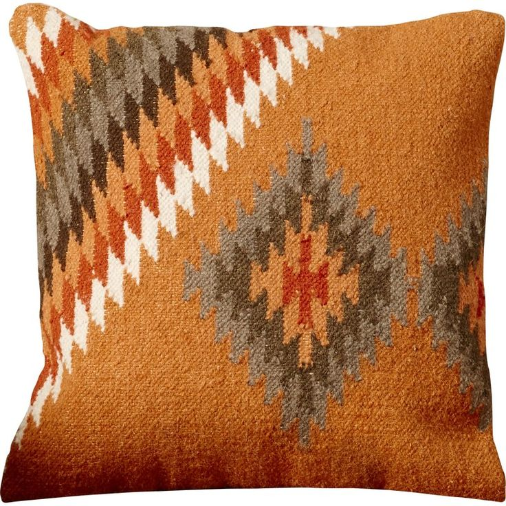 "Lend a touch of Southwestern-inspired style to any space in your home with this charming throw pillow. Showcasing a geometric block pattern, 100% linen cover, and classic 18"" square shape, this lovely pillow is the perfect accent for livening up an ensemble. Set it on your favourite living room arm chair, along with a burnt orange crocheted throw for a curated look, then pair it with a brown leather sofa, cowhide-inspired rug, and slatted-wood coffee table for a rustic arrangement. ..."