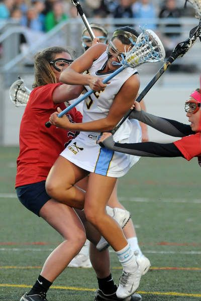 Cape's Kat Judge battles through a Worcester double team and scores in the Vikings' win over the Mallards. Click lacrosse photo to read entire sports article: No Easy Street as Cape beats Worcester 9-6 in girls lacrosse by Dave Frederick