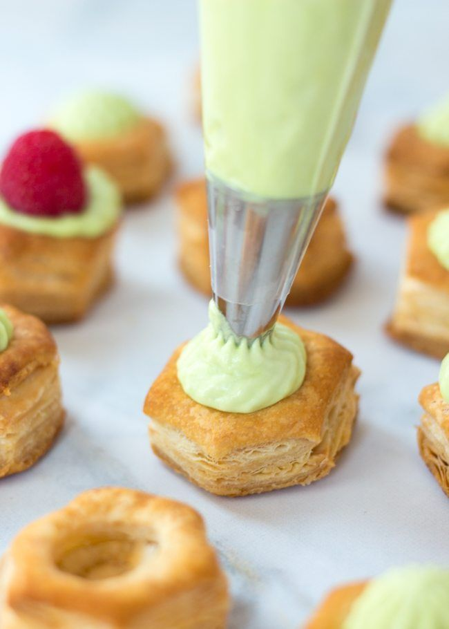 These Easy Raspberry and Pistachio Cream Puff Pastry Cups are perfect party dessert bites for summer.