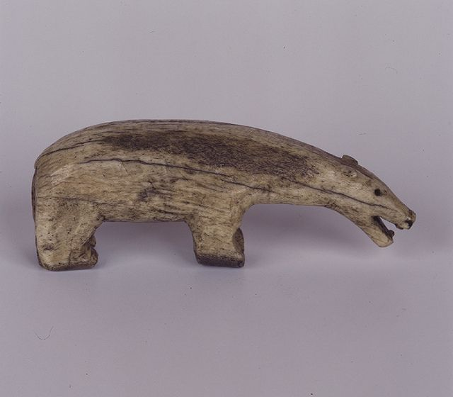Carved polar bear Carved animal figures could be used as toys or as amulets for protection. This polar bear is carved from ivory and dates from the 1800s. It was made in Alaska, USA. WA500040