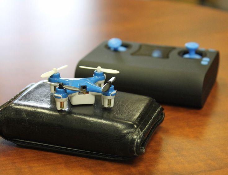 Wallet #Drone - World's Smallest #Quadcopter http://thegadgetflow.com/portfolio/wallet-drone-worlds-smallest-quadcopter/?utm_content=buffer497cd&utm_medium=pinterest&utm_source=pinterest.com&utm_campaign=buffer Charges inside a wallet sized controller!