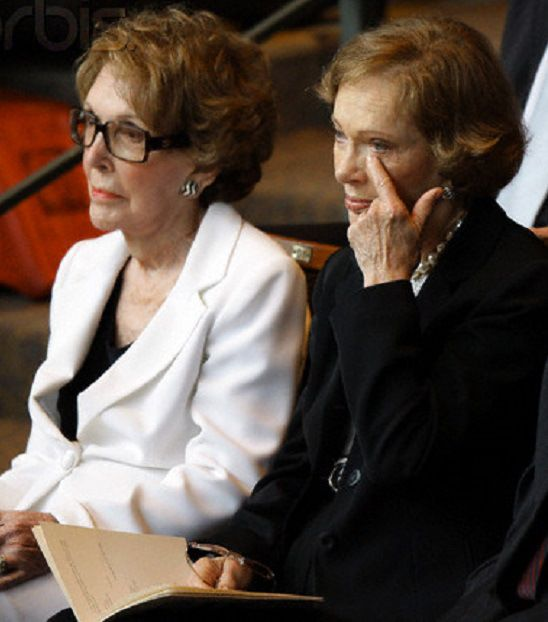 """Once considered political adversaries when their husbands ran against each other for President in 1980, former First Ladies Nancy Reagan and Rosalynn Carter mourn together the passing from their """"sorority"""" Lady Bird Johnson at her July 2007 funeral service."""