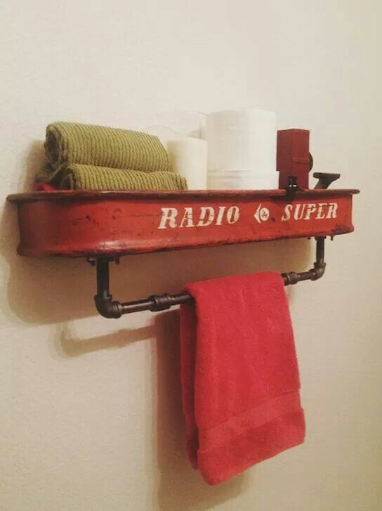 Towel bar made from an old radio flyer wagon..cuteness! Great for a kids bathroom!