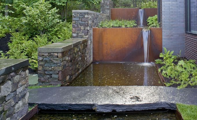 water: a water fall through Corten steel,  a reflecting pool, and a  stone bridge entry