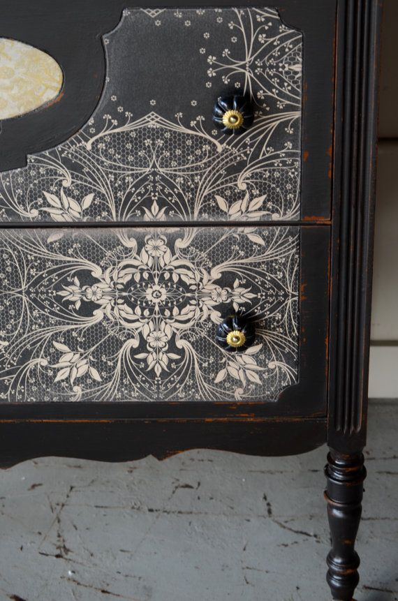 At first I thought this dresser was hand painted, but apparently it's really just decopaged wallpaper.