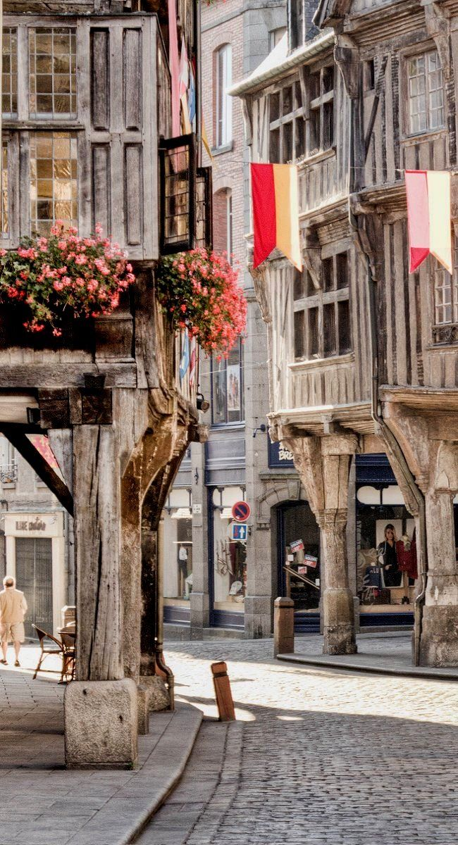 Dinan is a walled Breton town in Cotes-d'Armor ~ northwestern France.