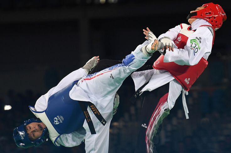 Best of 2016 - Thailand's Phannapa Harnsujin (L) competes against Iran's Kimia Alizadeh Zenoorin during their womens taekwondo repechage bout in the -57kg category as part of the Rio 2016 Olympic Games, on August 18, 2016, at the Carioca Arena 3, in Rio de Janeiro. #FYS #topshot #olympics #rio